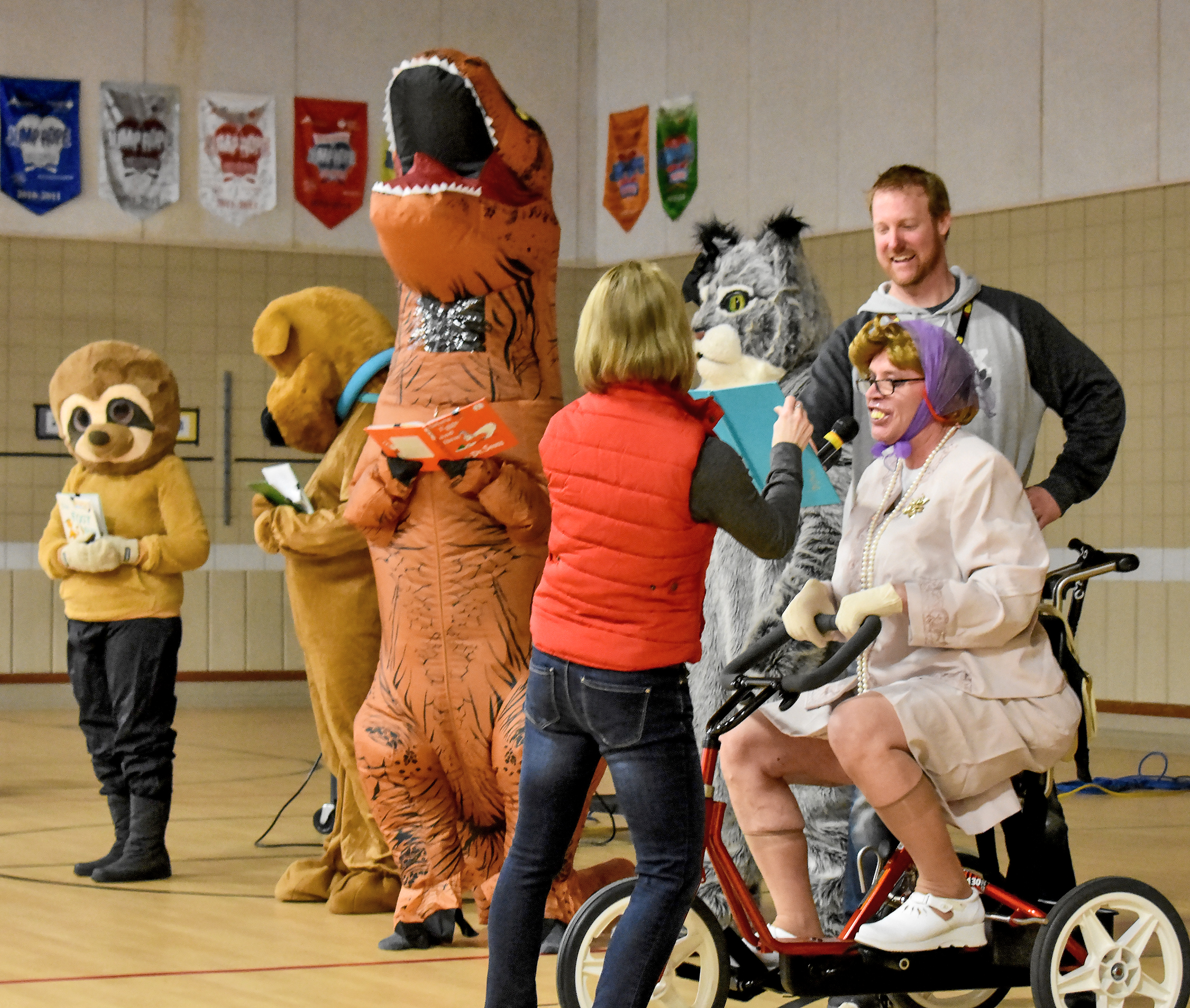 "Brandon Elementary students and staff celebrated Reading Across America Week last week with dress-up days and reading challenges, culminating in an all-school assembly Friday featuring four costumed ""mystery readers"" competing on a game show, plus special guest ""Old Lady"" (hilariously played by Principal Merle Horst). Schoolwide, students surpassed the reading goal for the week, tallying more than 31,000 minutes of reading in grades K-3. <strong>Jamie Hult/BV Journal</strong>*/"