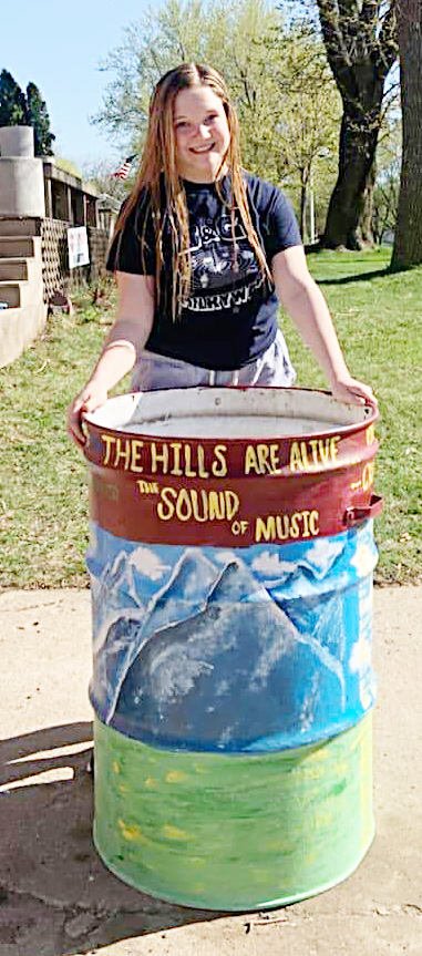"""<span style=""""font-size:11px;""""><span style=""""font-family:arial,helvetica,sans-serif;"""">Although the coronavirus cancelled Brandon Valley High's spring musical, <i>'The Sound of Music,'</i> Ellen Joseph paid tribute to the spring ritual with her artwork on a city-owned garbage can. Joseph is one of several Brandon residents who stepped up to decorate the garbage cans this year. In recent years, the city teamed up with local school art classes to paint the cans, but due to the coronavirus, city parks director Devin Coughlin opened it to the community this year. All 15 of the blank canvas garbage cans were spoken for in record time – 20 minutes to be exact, Coughlin said. The garbage cans can be spotted throughtou the city in parks and along popular walking paths. If you've put your artistic talents on a city garbage can, email your photo to <a href=""""mailto:editor@bvjournal.info"""">editor@bvjournal.info</a> to be printed in an upcoming issue of your hometown newspaper, the <i>Brandon Valley Journal. </i><strong>Submitted photo</strong></span></span>"""