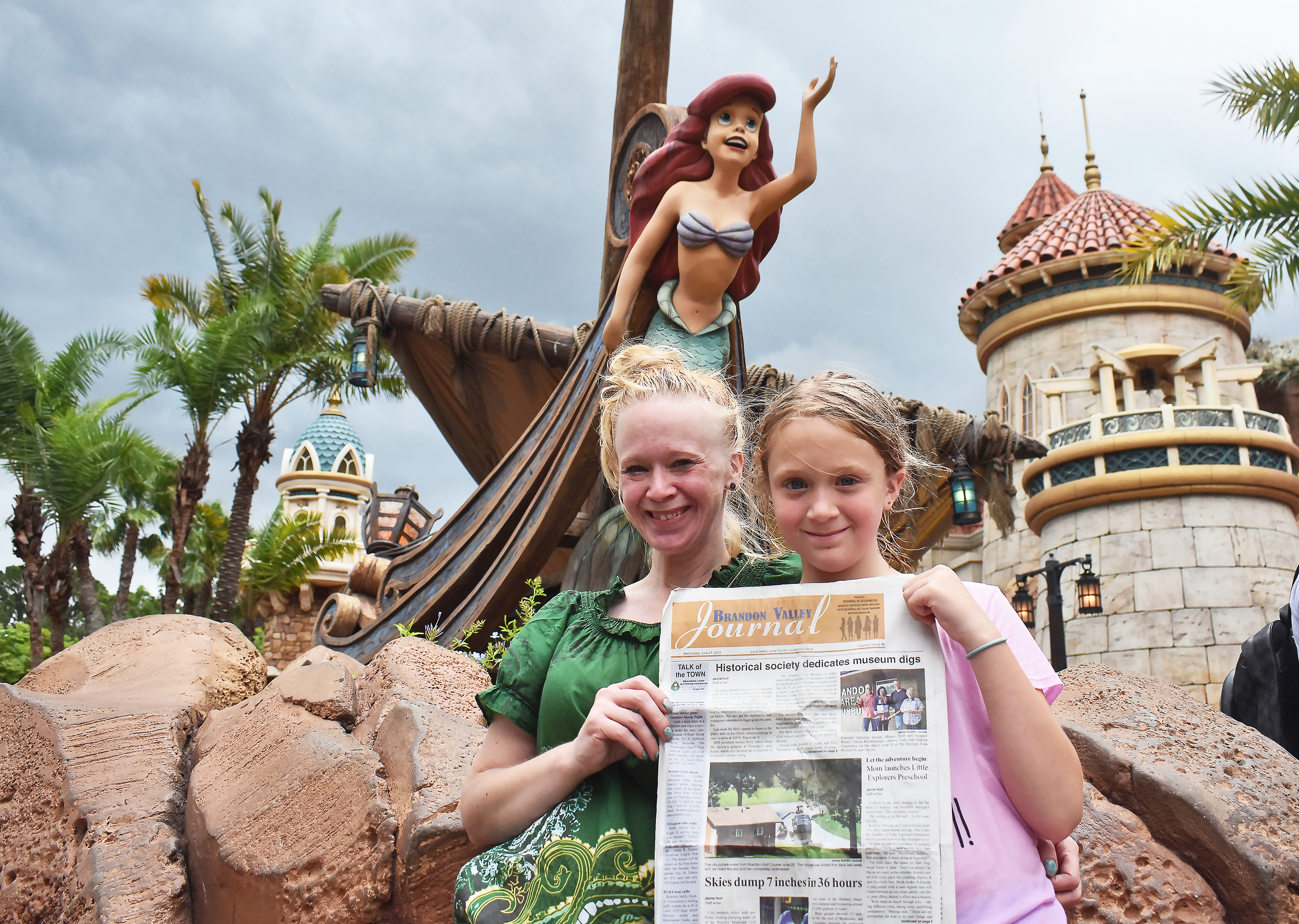 """<span style=""""font-size:10px;""""><i>Brandon Valley Journal </i>staffer Jamie Hult and her daughter, Greta, journey under the sea<span class=""""Apple-converted-space""""></span>with Ariel at Disney World last week with a copy<span class=""""Apple-converted-space""""></span>of the <i>Journal</i>. <strong>Submitted photo.</strong></span>*/"""