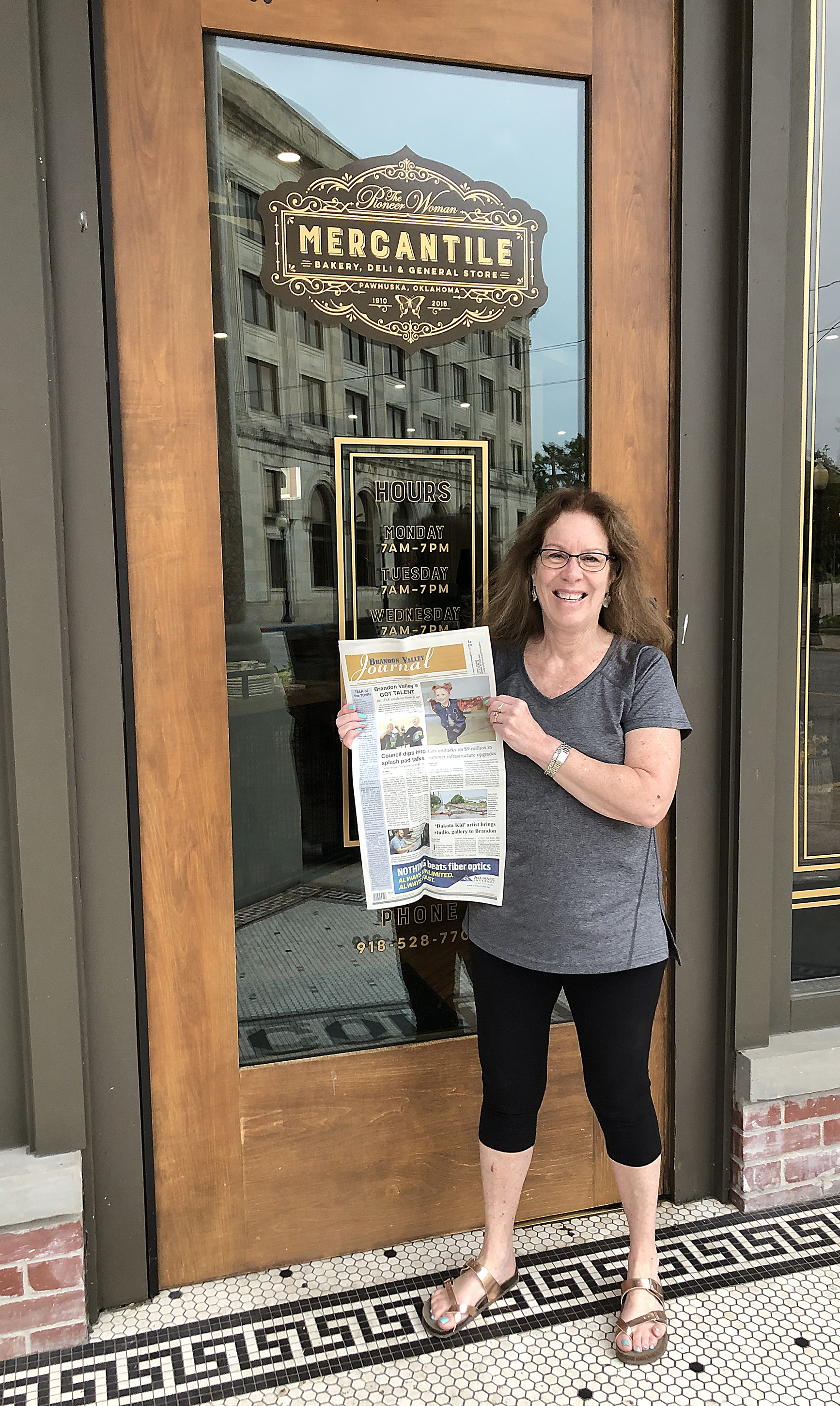 """<span class=""""s1"""">Cheryl Erickson is a fan of the Food Network's """"The Pioneer Woman"""", so much so, that she ventured there last week. The Brandon woman also brought the <i>Brandon Valley Journal</i> to the famed Mercantile, a bakery, deli and general store in Pawhuska, Okla., owned by the show's namesake Pioneer Woman, Ree Drummond. If you're venturing out this summer, remember to put the <i>Brandon Valley Journal</i> on your packing list.</span>*/"""