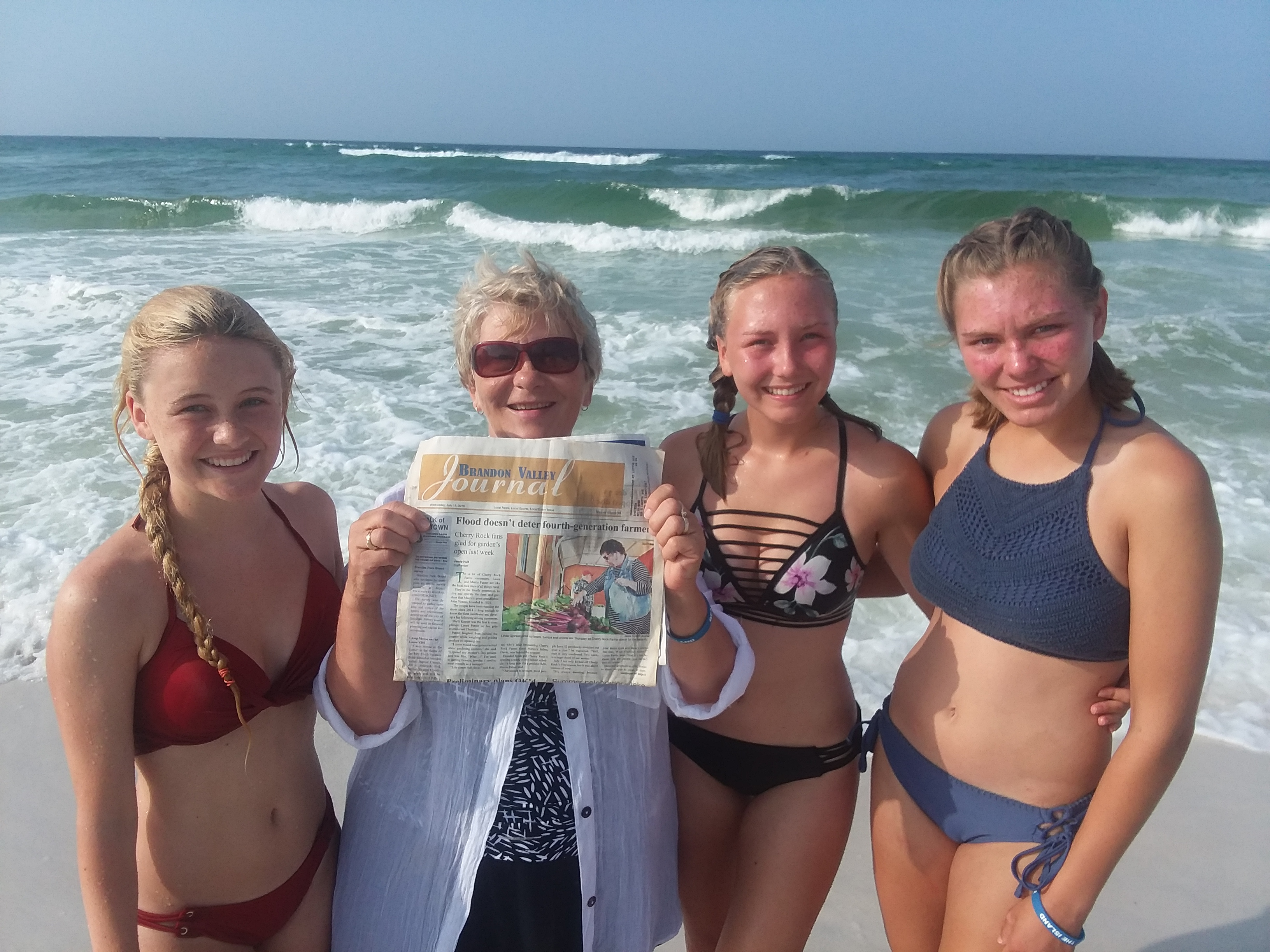 "Nelva Bose of Brandon soaks in the ocean in Destin, Fla., with her granddaughters <i>(from left)</i> Chloe Kilbride, Lauren VerSteeg and Kelsi VanSanten. Take your <i>Journal</i> on a journey, too, and capture the moment. Email photos to <a href=""mailto:editor@bvjournal.info"">editor@bvjournal.info</a>. <strong>Submitted photo.</strong>*/"