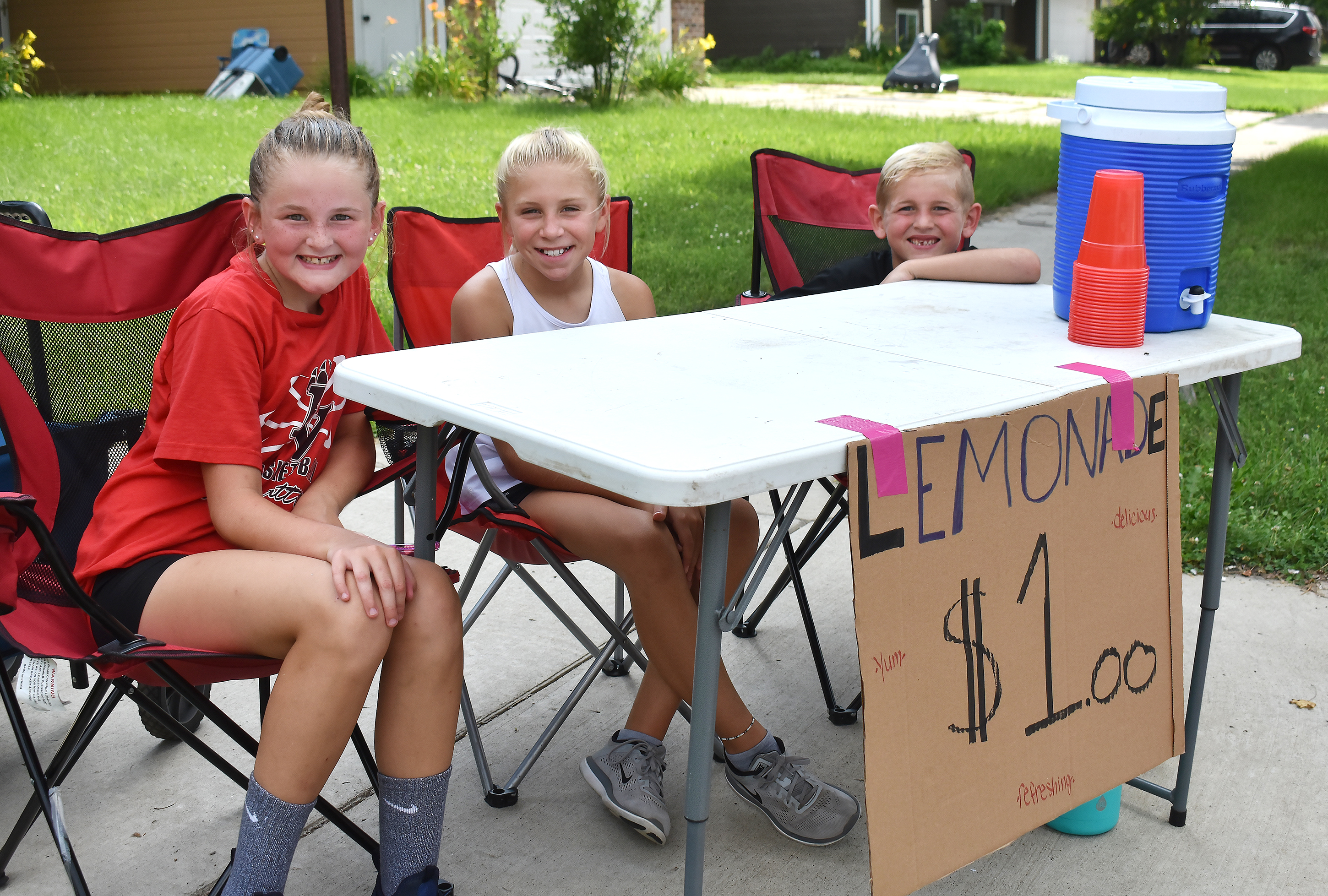 """<span class=""""s1"""">Tatum and Paxton Beckman and their friend, Shelby Bergan, sell lemonade in their neighborhood Friday in hopes of turning stand profits into extra spending cash. Tatum and Shelby, both 10, loaded up on Country Time pink lemonade and plastic cups at Dollar General before setting up shop near Robert Bennis Elementary. The friends headed to Oklahoma for church camp over the weekend and planned to hit the Omaha outlet malls on the way back, where Shelby supposed they might channel their hard-earned lemonade profits into new back-to-school clothes.<span class=""""Apple-converted-space""""><strong>Jamie Hult/BV Journal</strong></span></span>*/"""