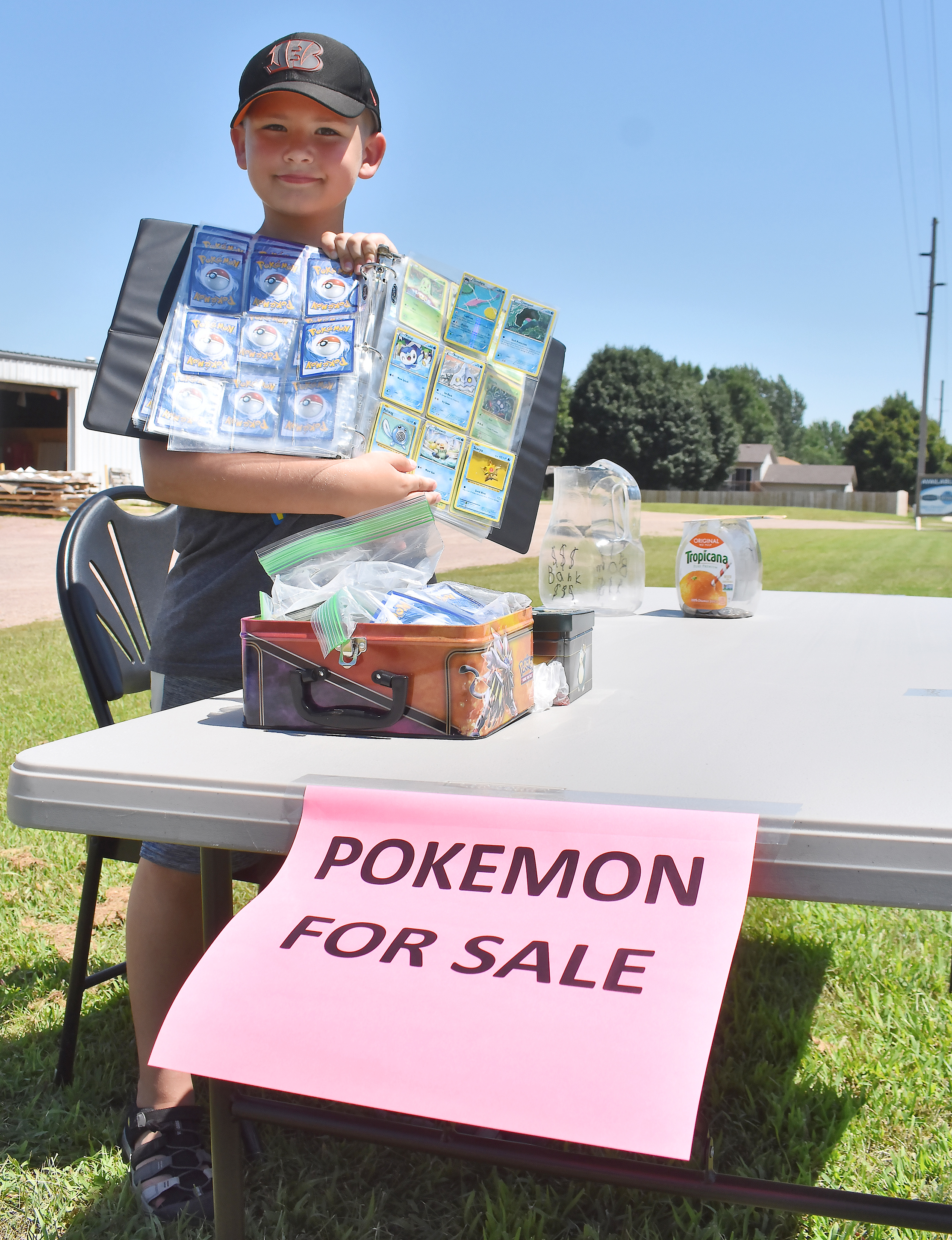"<span class=""s1"">Pokemon enthusiast Lukas Rodne sells trading cards on Aspen Boulevard Friday afternoon. The 9-year-old entrepreneur, who has, ""like a thousand cards, maybe,"" is selling some of his current collection ""basically, so I can buy more rare cards."" His mom said she was proud of him for bearing the heat. ""He's been asking for weeks,"" she added. ""I think it's super cute."" Within his first hour in business, Lukas had two popsicles to stay cool.<span class=""Apple-converted-space""> <strong>Jamie Hult/BV Journal</strong></span></span>*/"