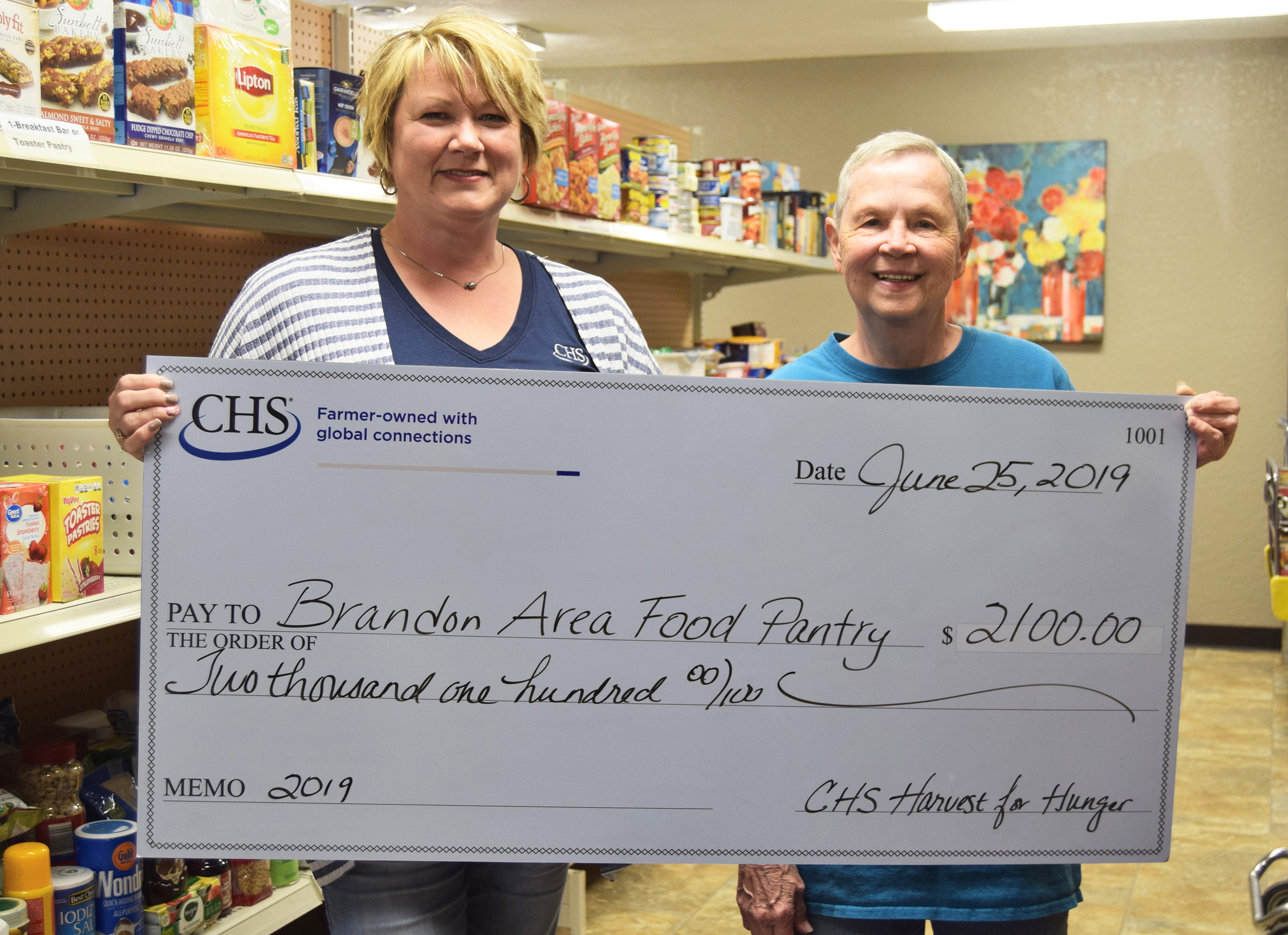 "<span class=""s1"" style=""letter-spacing: -0.1px;"">Diana Nelson (left), CHS administrative assistant, delivers a check to Linda Weber at the Brandon Area Food Pantry for $2,100.</span>	<span class=""s1"" style=""letter-spacing: -0.1px;"">Working together, CHS joined the fight against rural hunger through the cooperative's annual Harvest for Hunger food, funds and grain drive. The campaign gathered more than $500,000 and 94,959 pounds of food. Locally, CHS raised $48,858.36 and 309 pounds of food for local food shelves.<span class=""Apple-converted-space""> </span></span>	<span class=""s1"" style=""letter-spacing: -0.1px;"">Since 2011, CHS Country Operations, a division of CHS, has gathered money and food for local and regional food shelves. With this year's total, the cooperative has now raised more than $6 million and 4.5 million pounds of food over nine years.<span class=""Apple-converted-space""> </span></span>	<span class=""s1"" style=""letter-spacing: -0.1px;"">CHS locations in southeast South Dakota, southwest Minnesota and northeast Nebraska corridor participated in the 2019 Harvest for Hunger drive held March 1-20 through a variety of fundraising activities, including raffle sales and a chili cook-off. <span class=""Apple-converted-space""> </span></span>	<span class=""s2"" style=""letter-spacing: -0.2px;"">""CHS Harvest for Hunger campaign is organized by our cooperative, but it is because of the generous contributions made by our employees, customers and community members that we can make such an impactful difference for those in need,"" says Kent Mulder, general manager.<span class=""Apple-converted-space""> </span></span>	<span class=""s2"" style=""letter-spacing: -0.2px;"">Based on the funds raised, CHS also contributed matching Harvest for Hunger campaign dollars back to local food shelves and other charitable organizations.</span><span class=""s1"" style=""letter-spacing: -0.1px;""> </span>"