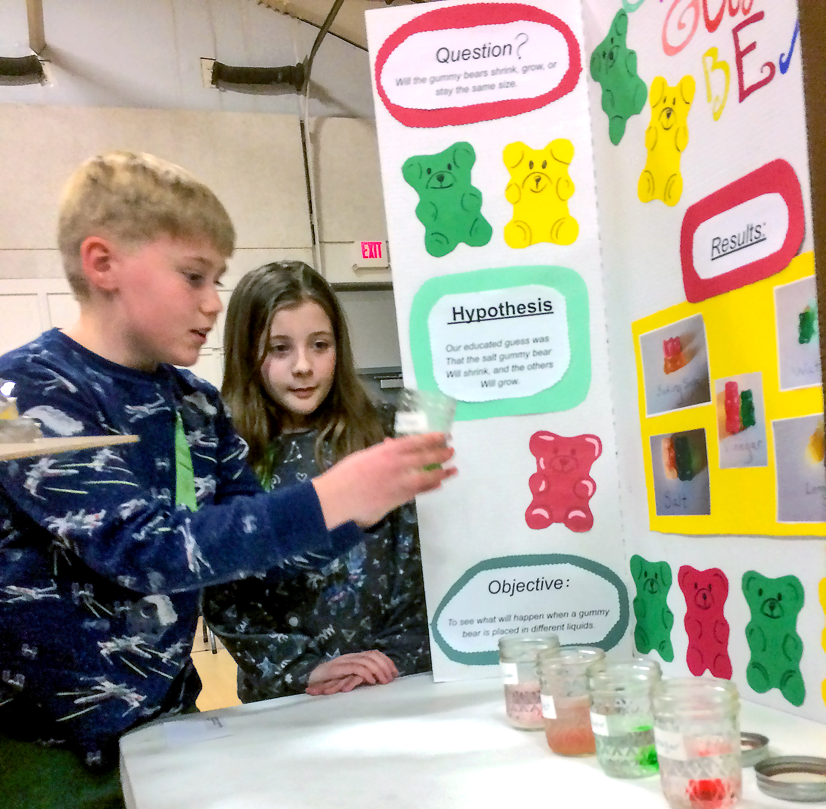 "<span class=""s1"">Fourth-graders Charlie Peterson and Holly Jacobson demonstrate their project, ""Growing Gummy Bears,"" to judges at the Valley Springs Elementary science fair March 7. <strong>Jamie Hult/BV Journal</strong></span>*/"