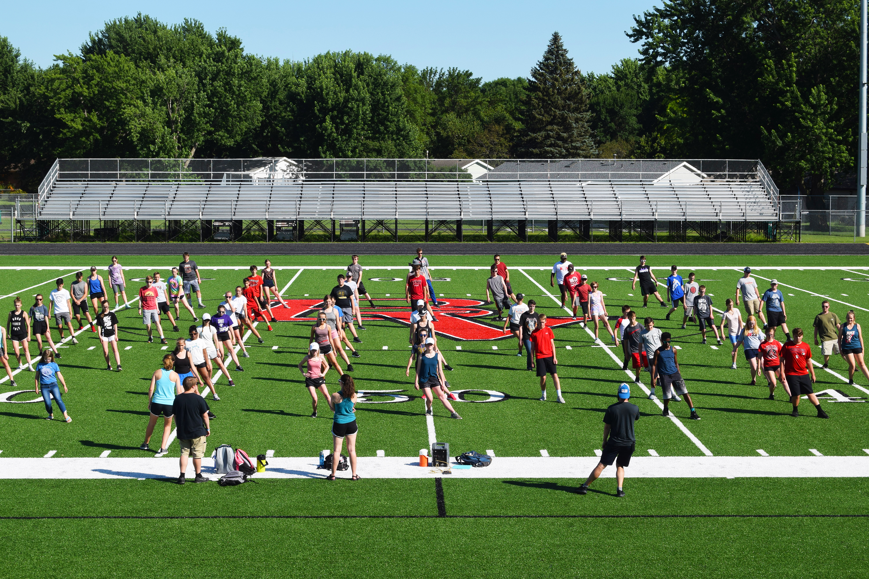 """<span class=""""s1"""">BVHS band director Tyler Nettestad leads marching band members July 15 in stretches at the first drill practice for this years' show, """"Breathe."""" The public can see the show at the band's annual Marching &amp; Melon Madness on Friday, Aug. 23.<span class=""""Apple-converted-space""""><strong>McClane Archer/BV Journal</strong></span></span>*/"""