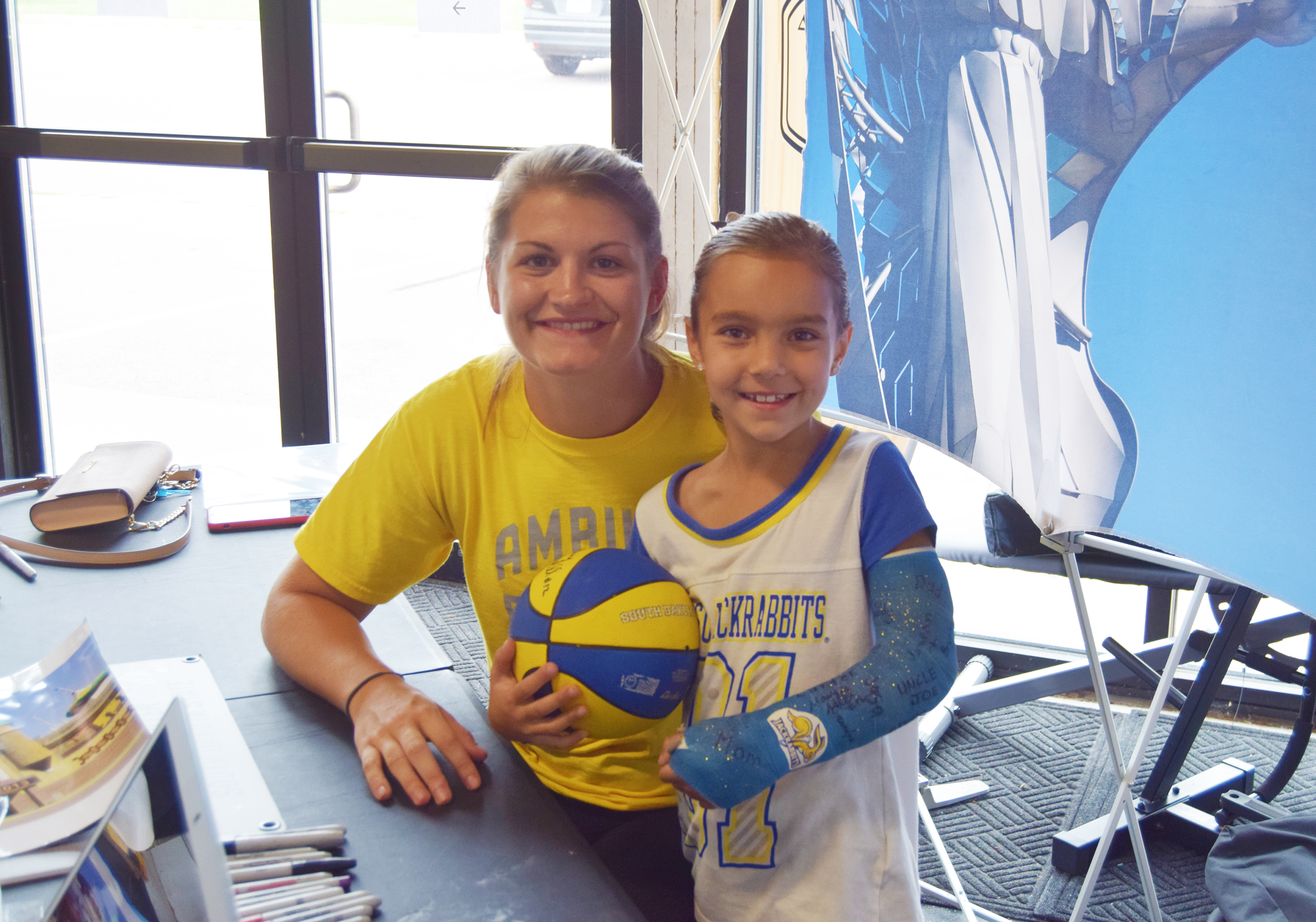 Macy Miller, all-time leading scorer in South Dakota State University and Summit League women's basketball history, stopped by Brandon's Ambush Basketball Friday to sign autographs and inspire local youth basketball players. For second-grader, Kamryn Darling, one of Miller's prized authographs went on her arm cast. <strong>McClane Archer/BV Journal</strong>*/